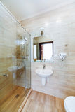 Small bathroom of the hotel rooms, with shower and washbasin Stock Images