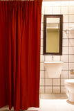 Small bathroom red curtain Stock Photo