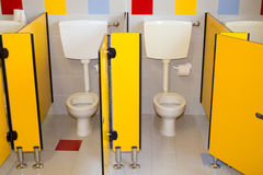 Small bathroom of a school for children with water closet Stock Photos
