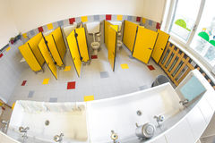 Small bathroom of a school for children with water closet stock image