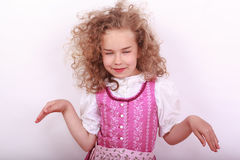 Small Bavarian girl in the dirndl in pose Royalty Free Stock Images