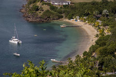 Small bay on Antigua. View on small bay with boats and sandy beach at English Harbour on Caribbean island of Antigua Royalty Free Stock Image