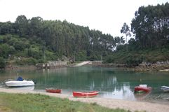 A small bay and the boat. A small inlet where boat are dock into the water when the tide is high stock photo