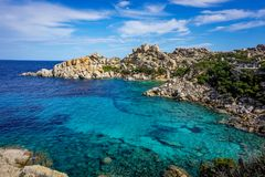 Small bay with a clear colorful water stock images