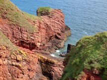 Bay in the Arbroaht Cliffs. A small bay between the cliff rocks at Arbroath on the North Sea in Scotland Stock Photo