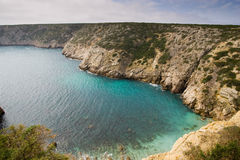 Small Bay in Portugal. A small bay in the Algarve with clear emerald water, on the way to Cape Saint Vincent, Sagres, Portugal Royalty Free Stock Image