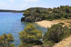 Small bay with a sandy beach on the Aegean Sea. Stock Image
