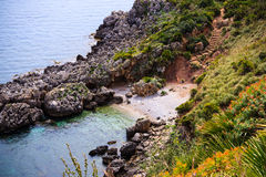 Small bay in Sicily. Stairway sloping down to the sea in Zingaro Natural Reserve, Sicily, Italy Royalty Free Stock Photography