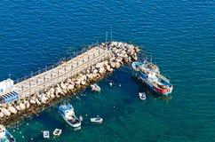 Small bay in Sorrento seacoast, Italy. Small bay with breakwater in Sorrento seacoast, Gulf of Naples, Italy stock images