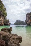 Small bay surrounded by intricate limestone,soft white sand beach and emerald color sea at Lading island, Thailand. Small bay surrounded by intricate limestone stock photography