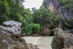 Small bay surrounded by intricate limestone,soft white sand beach and emerald color sea at Lading island, Thailand. Small bay surrounded by intricate limestone royalty free stock image