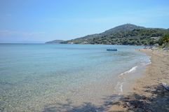 Small beach in Greece with clear sea water and forest. Beautiful beach of Moraitika with turquoise blue sea, Corfu island - Greece Royalty Free Stock Photos
