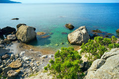 Small beach among the rocks . Royalty Free Stock Image