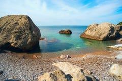 Small beach among the rocks . Stock Photos