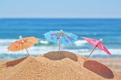 Small beach umbrellas on a beach . Stock Photos