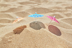 Small beach umbrellas on the beach. Stock Photography