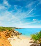 Small beach under a cloudy sky in Sardinia Stock Photo