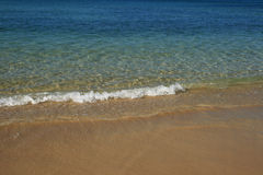 Small beach wave Royalty Free Stock Images