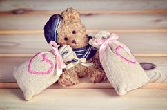 Small bear with bags with hearts. Royalty Free Stock Photos