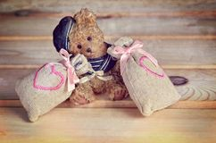 Small bear with bags with hearts. Royalty Free Stock Photography