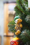 Small bear toy on the christmas tree Royalty Free Stock Images