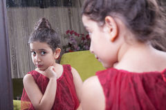 Small beautiful arab middle eastern girl with pretty red dress a Stock Images