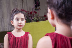 Small beautiful arab middle eastern girl with pretty red dress a Royalty Free Stock Photography