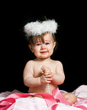 Small beautiful baby girl in a angel fansy dress stock photography