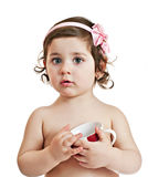 Small beautiful baby girl with cup Stock Image
