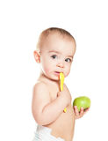 Small beautiful baby girl with green apple Royalty Free Stock Photos