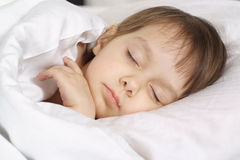 A small beautiful baby sleeps Royalty Free Stock Image