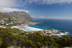Small beautiful beach front town. Llandudno beach in Cape Town, South Africa, facing out onto the Atlantic Ocean Royalty Free Stock Photos
