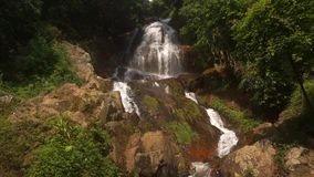Cascade waterfall in picturesque jungle rainforest. Small beautiful cascade waterfall in the picturesque jungle rainforest. Stream of mountain fresh water flows stock footage