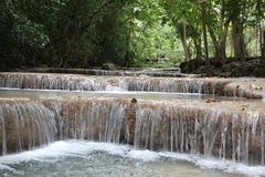 Small beautiful cascading waterfall in the jungle Stock Photo