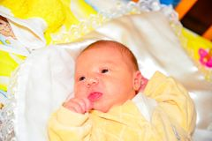 A small and beautiful child lies in the arena and looks at a new world for him.  royalty free stock photos