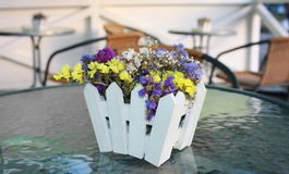 Small beautiful flowers.Ikebana. Beautiful decoration of summer cafe Royalty Free Stock Image