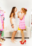 Small beautiful girl applies make-up on her friend Royalty Free Stock Photography