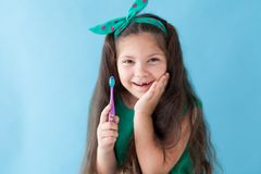 Small beautiful girl cleans teeth toothbrush Dentistry. Small beautiful girl cleans teeth toothbrush Pediatric Dentistry royalty free stock photography