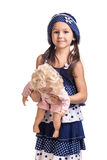 The small beautiful girl with a doll Royalty Free Stock Photo