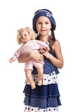 The small beautiful girl with a doll Royalty Free Stock Image