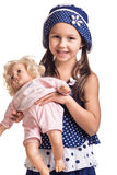 The small beautiful girl with a doll Royalty Free Stock Photography