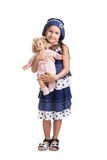 The small beautiful girl with a doll Stock Images