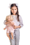 The small beautiful girl with a doll Stock Photography