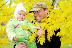 Small beautiful girl in green suit with father Royalty Free Stock Photography