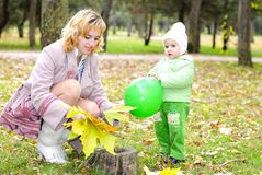 Small beautiful girl in green suit with mother Royalty Free Stock Photo