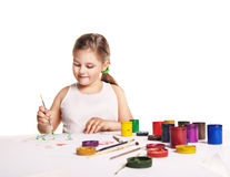 Small beautiful girl paints on paper over white Stock Photo