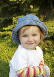 Small beautiful girl smiles Stock Image