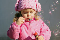 The small beautiful girl with soap bubbles Royalty Free Stock Image