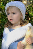 The small beautiful girl in white cap Royalty Free Stock Image