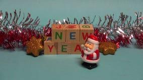 Small beautiful Santa Claus toy walking near Christmas New year decorations stock video